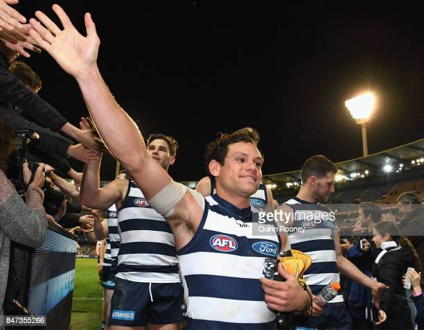 Steven Motlop of the Cats high fives fans after winning the Second Semi Final AFL match between the Geelong Cats and the Sydney Swans at Melbourne...