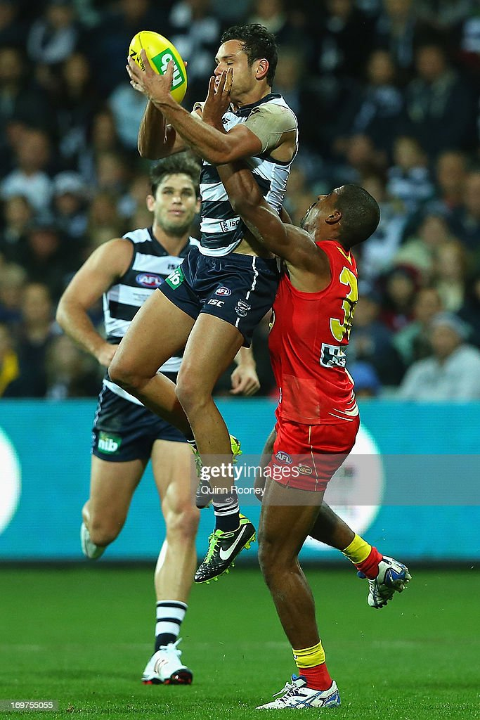 Steven Motlop of the Cats marks infront of Joel Wilkinson of the Suns during the round ten AFL match between the Geelong Cats and the Gold Coast Suns at Simonds Stadium on June 1, 2013 in Geelong, Australia.