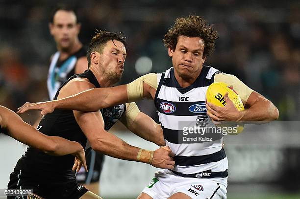 Steven Motlop of the Cats tries to avoid a tackle by Travis Boak of the Power during the round five AFL match between the Port Adelaide Power and the...