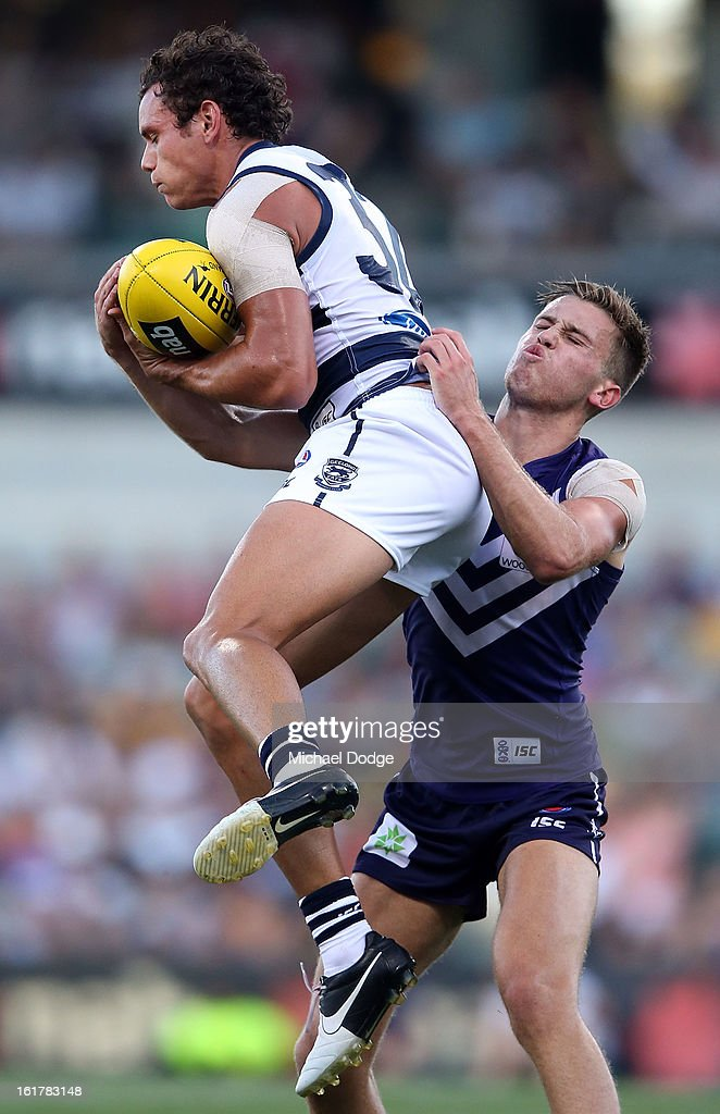 Steven Motlop of the Geelong Cats marks the ball during the round one NAB Cup AFL match between the Fremantle Dockers and the Geelong Cats at Patersons Stadium on February 16, 2013 in Perth, Australia.