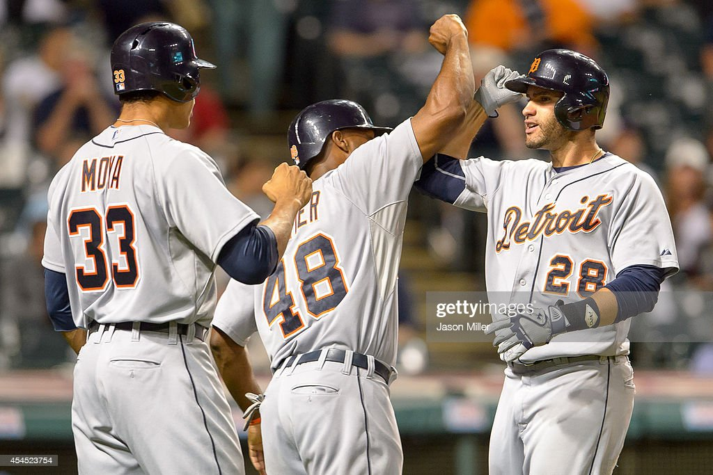 Steven Moya #33 and Torii Hunter #48 of the Detroit Tigers celebrate with J.D. Martinez #28 after all scored on Martinez's home run during the ninth inning against the Cleveland Indians at Progressive Field on September 2, 2014 in Cleveland, Ohio. The Tigers defeated the Indians 4-2.