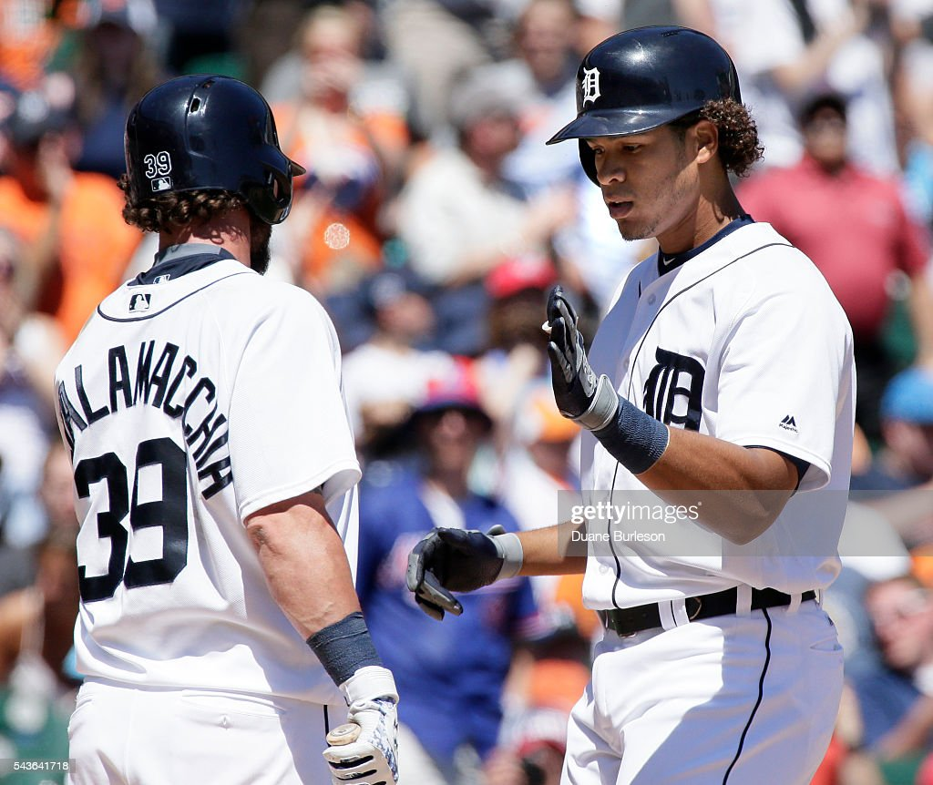 Steven Moya #33 of the Detroit Tigers is congratulated by <a gi-track='captionPersonalityLinkClicked' href=/galleries/search?phrase=Jarrod+Saltalamacchia&family=editorial&specificpeople=836404 ng-click='$event.stopPropagation()'>Jarrod Saltalamacchia</a> #39 of the Detroit Tigers after hitting a solo home run against the Miami Marlins during the fifth inning at Comerica Park on June 29, 2016 in Detroit, Michigan. The Tigers defeated the Marlins 10-3.