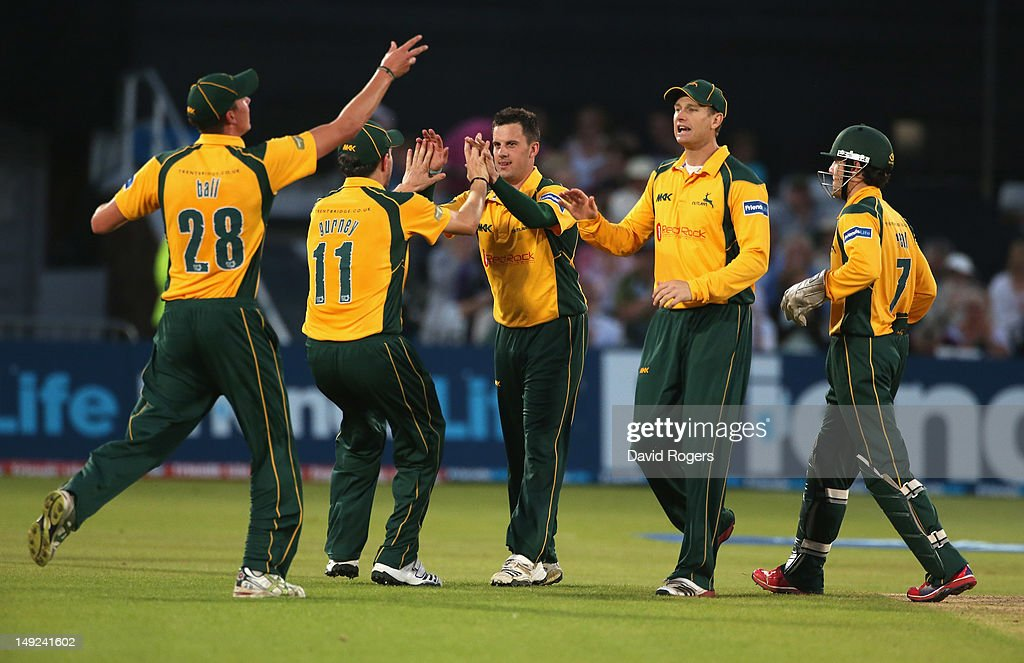 Steven Mullaney of Nottinghamshire is congratulated by team mates after taking the wicket of Simon Katich during the Friends Life T20 match between Nottinghamshire and Hampshire at Trent Bridge on July 25, 2012 in Nottingham, England.
