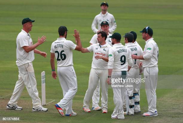 Steven Mullaney of Nottinghamshire is congratulated on the wicket of Matt Coles of Kent after he was caught by Riki Wessells during the Specsavers...