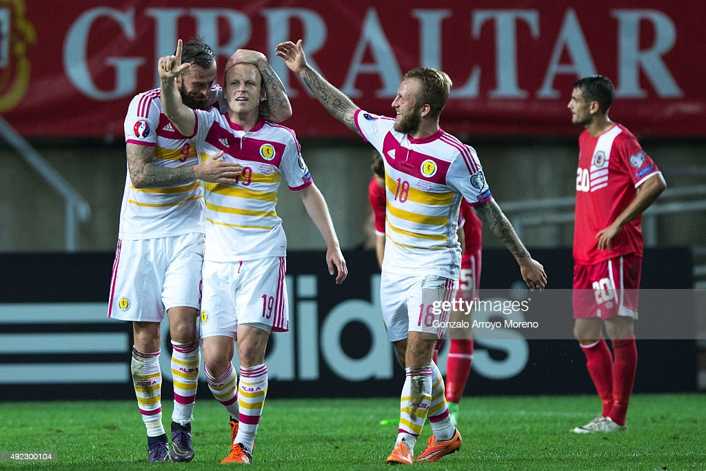 Steven Naismith (2ndL) celebrates scoring their sixth goal with teammates Steven Fletcher (L) and Johnny Russell (R) during the UEFA EURO 2016 Qualifying round Group G match between Gibraltar and Scotland at Estadio Algarve on October 11, 2015 in Faro, Portugal.