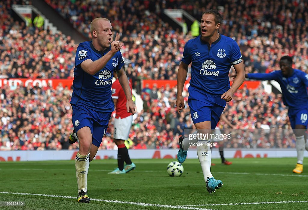 Steven Naismith of Everton celebrates scoring his team's first goal during the Barclays Premier League match between Manchester United and Everton at Old Trafford on October 5, 2014 in Manchester, England.