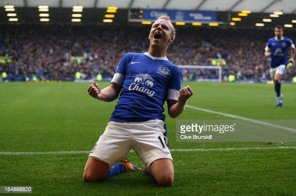 Steven Naismith of Everton celebrates scoring his team's second goal during the Barclays Premier League match between Everton and Liverpool at...