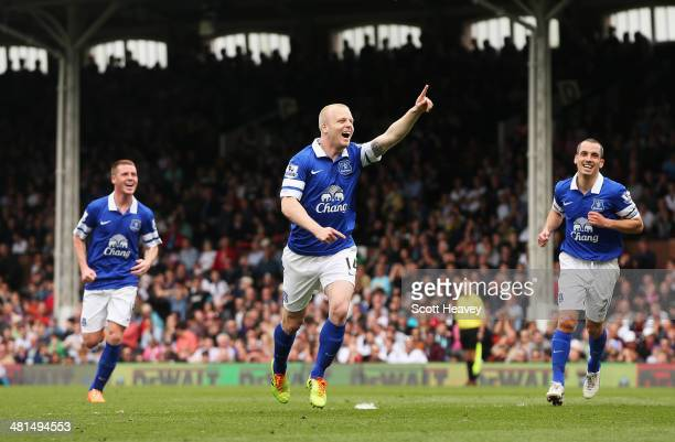 Steven Naismith of Everton celebrates the opening goal an own goal by David Stockdale of Fulham during the Barclays Premier League match between...