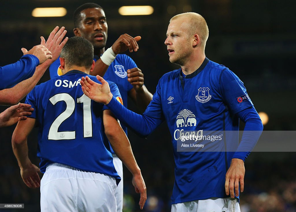 Steven Naismith of Everton (R) celebrates with Leon Osman (21) and Sylvain Distin (2R) as he scores their third goal during the UEFA Europa League Group H match between Everton FC and LOSC Lille at Goodison Park on November 6, 2014 in Liverpool, United Kingdom.