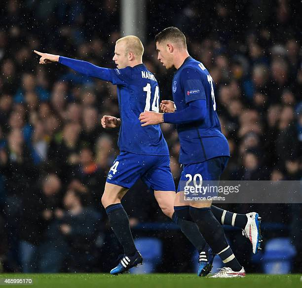 Steven Naismith of Everton celebrates with teammate Ross Barkley after scoring a goal to level the scores at 11 during the UEFA Europa League Round...