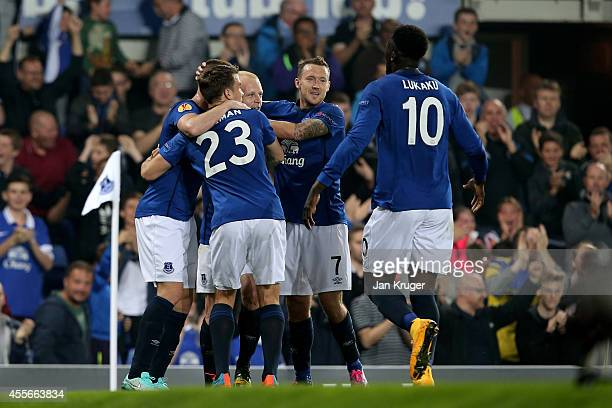 Steven Naismith of Everton celebrates with teammates after scoring the opening goal during the UEFA Europa League Group H match between Everton and...