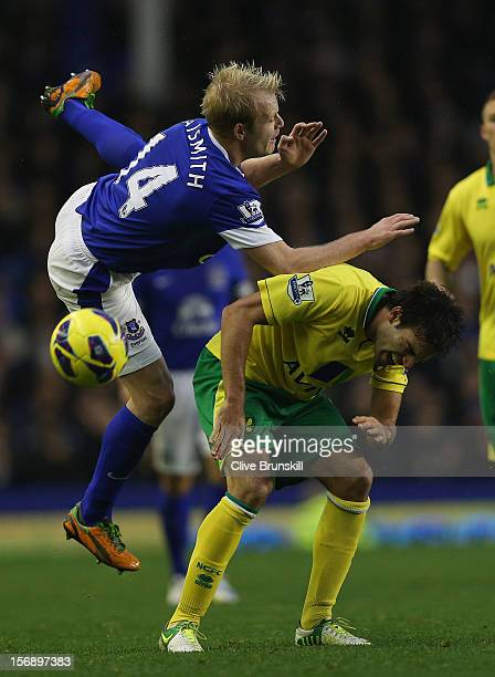 Steven Naismith of Everton clashes with Javier Garrido of Norwich City during the Barclays Premier League match between Everton and Norwich City at...