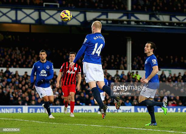Steven Naismith of Everton heads in their third goal during the Barclays Premier League match between Everton and Queens Park Rangers at Goodison...