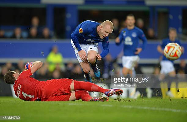 Steven Naismith of Everton is fouled by goalkeeper Marco Wolfli of BSC Young Boys to win a penalty during the UEFA Europa League Round of 32 match...
