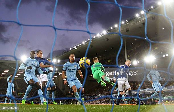 Steven Naismith of Everton scores a goal to level the scores at 11 during the Barclays Premier League match between Everton and Manchester City at...