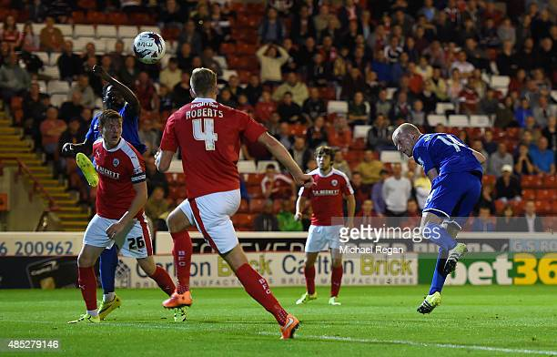 Steven Naismith of Everton scores with a header during the Capital One Cup second round match between Barnsley and Everton at Oakwell Stadium on...