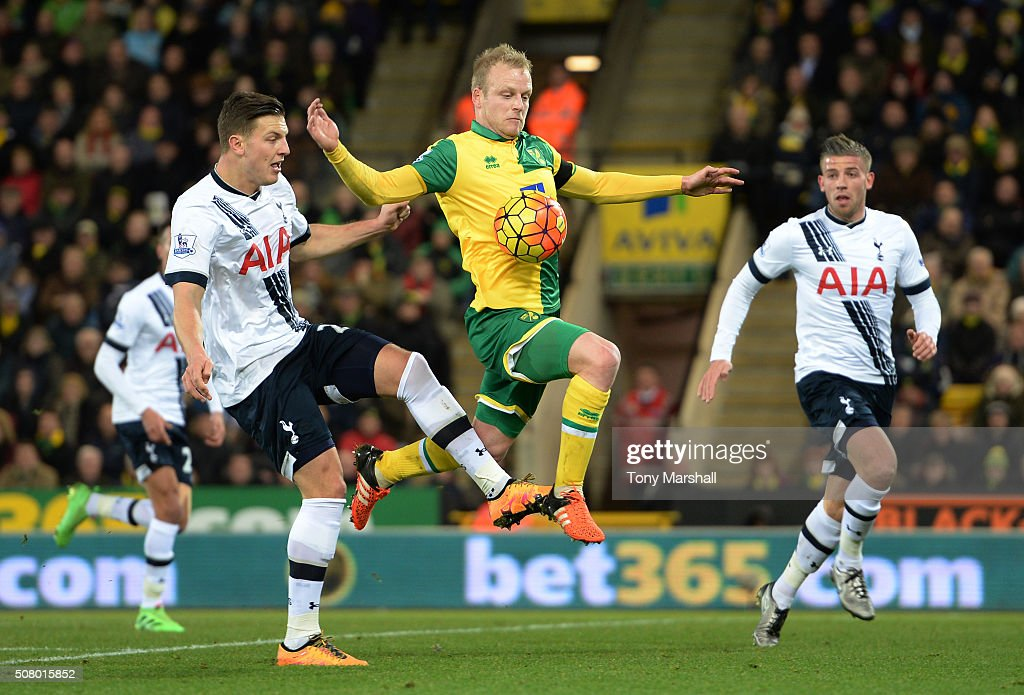 Steven Naismith of Norwich City and Kevin Wimmer of Tottenham Hotspur compete for the ball during the Barclays Premier League match between Norwich City and Tottenham Hotspur at Carrow Road on February 2, 2016 in Norwich, England.