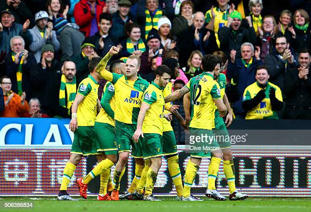 Steven Naismith of Norwich City celebrates scoring his team's second goal with his team mates during the Barclays Premier League match between...