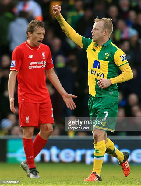 Steven Naismith of Norwich City celebrates scoring his team's second goal during the Barclays Premier League match between Norwich City and Liverpool...