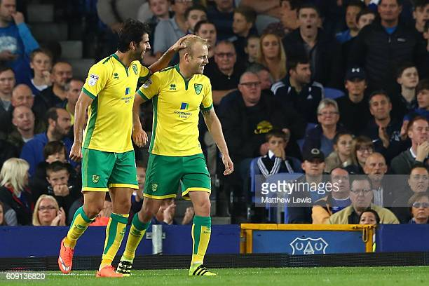 Steven Naismith of Norwich City celebrates scoring the opening goal with Nelson Oliveira during the EFL Cup Third Round match between Everton and...