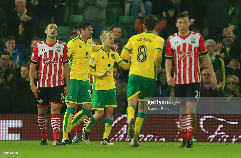 Steven Naismith of Norwich City celebrates with team mates after scoring his sides second goal during the Emirates FA Cup Third Round match between Norwich City and Southampton at Carrow Road on January 7, 2017 in Norwich, England.