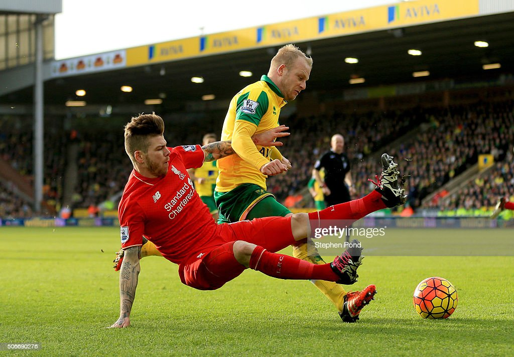 Steven Naismith of Norwich City is fouled by Alberto Moreno of Liverpool resulting in the penalty kick during the Barclays Premier League match between Norwich City and Liverpool at Carrow Road on January 23, 2016 in Norwich, England.