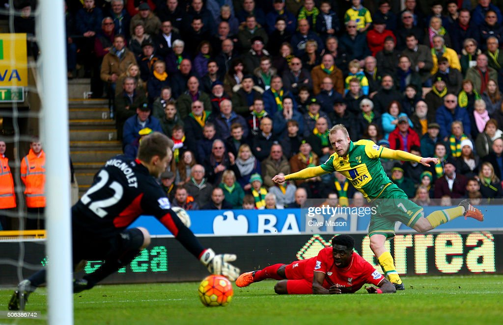 <a gi-track='captionPersonalityLinkClicked' href=/galleries/search?phrase=Steven+Naismith&family=editorial&specificpeople=4130861 ng-click='$event.stopPropagation()'>Steven Naismith</a> of Norwich City scores his team's second goal past <a gi-track='captionPersonalityLinkClicked' href=/galleries/search?phrase=Simon+Mignolet&family=editorial&specificpeople=7124442 ng-click='$event.stopPropagation()'>Simon Mignolet</a> of Liverpool during the Barclays Premier League match between Norwich City and Liverpool at Carrow Road on January 23, 2016 in Norwich, England.