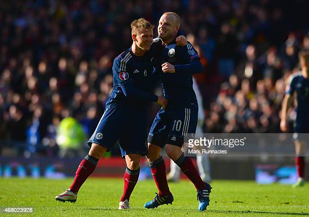 Steven Naismith of Scotland celebrates scoring their fourth goal with Matt Ritchie of Scotland during the EURO 2016 Qualifier match between Scotland...