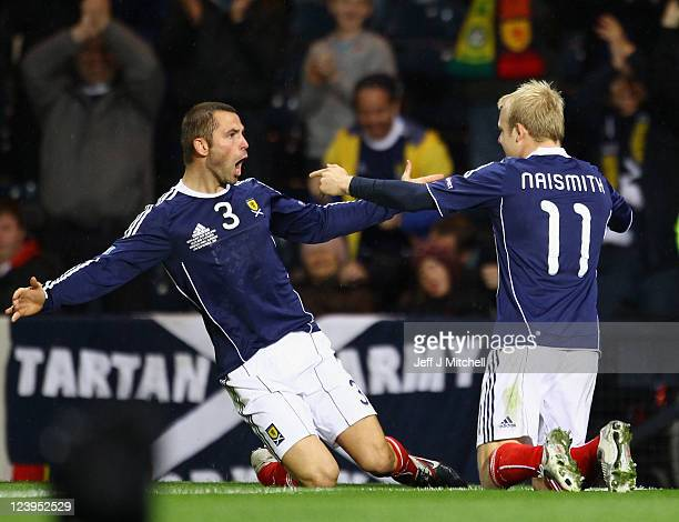 Steven Naismith of Scotland celebrates with Phil Bardsley after scoring during the UEFA EURO 2012 Group I qualifying match between Scotland and...