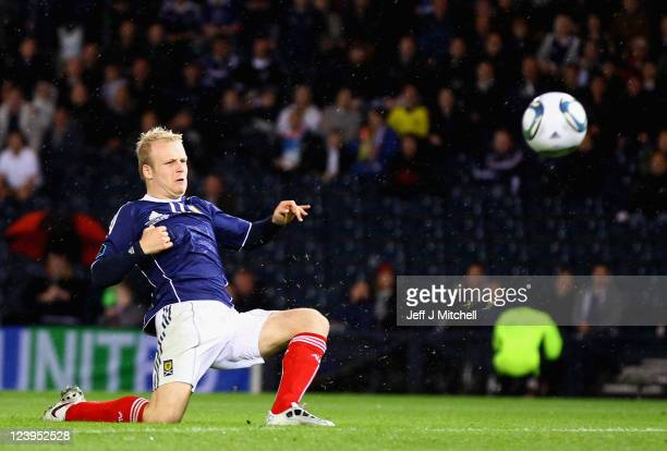Steven Naismith of Scotland scores during the UEFA EURO 2012 Group I qualifying match between Scotland and Lithuania at Hampden Park on September 6...