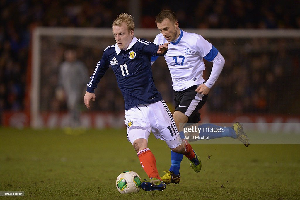 Steven Naismith of Scotland tackles Enar Jaager of Estonia during the international friendly match between Scotland and Estonia at Pittodrie Stadium on February 6, 2013 in Aberdeen, Scotland.