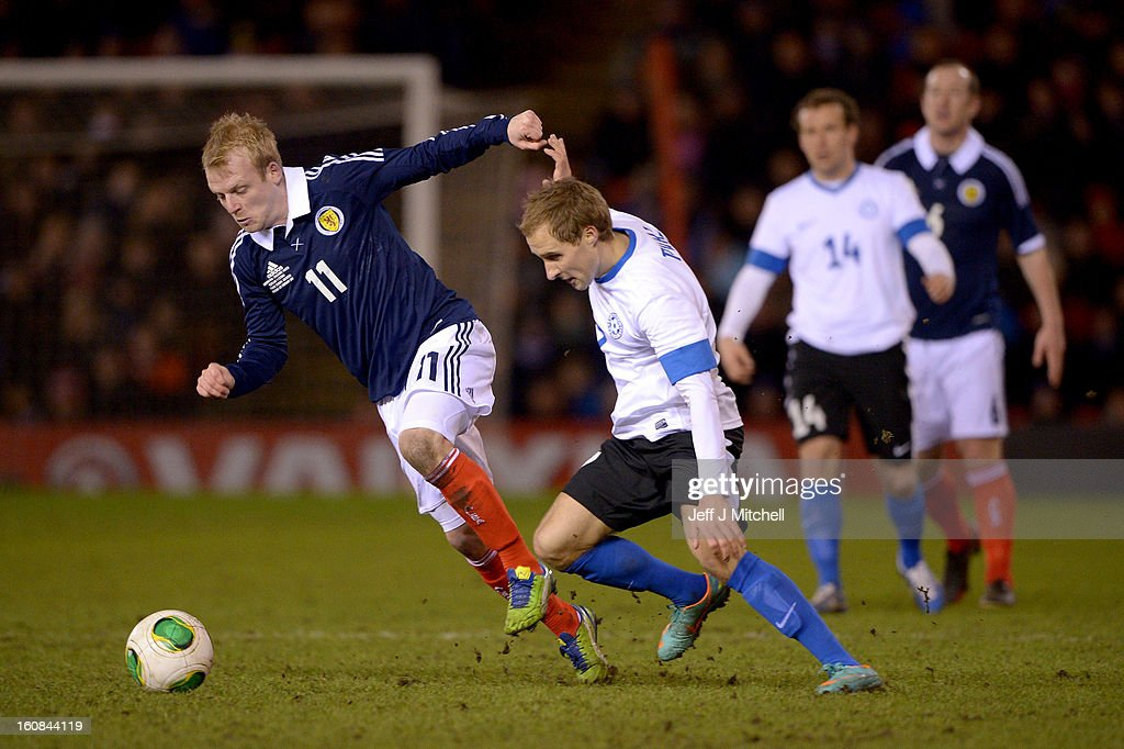 Steven Naismith of Scotland tackles Sander Puri of Estonia during the international friendly match between Scotland and Estonia at Pittodrie Stadium on February 6, 2013 in Aberdeen, Scotland.