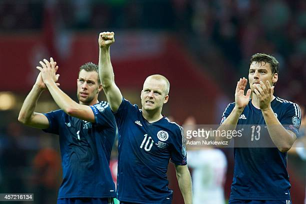 Steven Naismith of Scotland thanks to fans for their support after the UEFA EURO 2016 qualifying match between Poland and Scotland at the National...