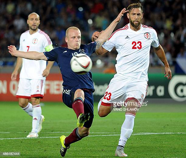 Steven Naismith of Scotland vie for a ball with Levan Mchedlidze of Georgia during their Euro 2016 qualifying football match between Georgia and...