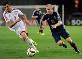 Steven Naismith of Scotland vies for a ball with Solomon Kverkvelia of Georgia during their Euro 2016 qualifying football match between Georgia and...