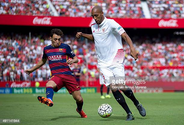 Steven N'Kemboanza Mike N'Zonzi of Sevilla FC competes for the ball with Munir el Haddadi of FC Barcelona during the La Liga match between Sevilla FC...