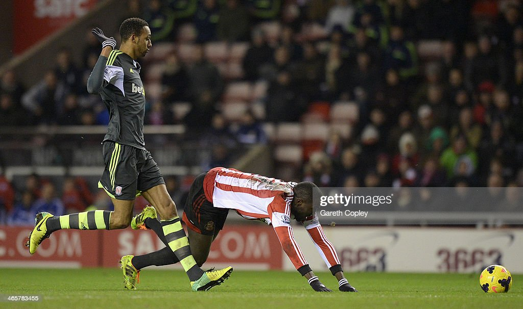 Steven N'Zoni of Stoke City brings down Jozy Altidore of Sunderland to be sent off during the Premier League match between Sunderland and Stoke City at Stadium of Light on January 29, 2014 in Sunderland, England.