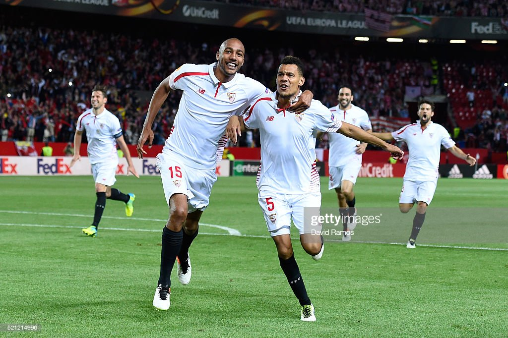 <a gi-track='captionPersonalityLinkClicked' href=/galleries/search?phrase=Steven+N%27Zonzi&family=editorial&specificpeople=6324480 ng-click='$event.stopPropagation()'>Steven N'Zonzi</a> and Timothee Kolodziejczak of Sevilla celebrate victory after the penalty shoot out during the UEFA Europa League quarter final, second leg match between Sevilla and Athletic Bilbao at the Ramon Sanchez Pizjuan stadium on April 14, 2016 in Seville, Spain.