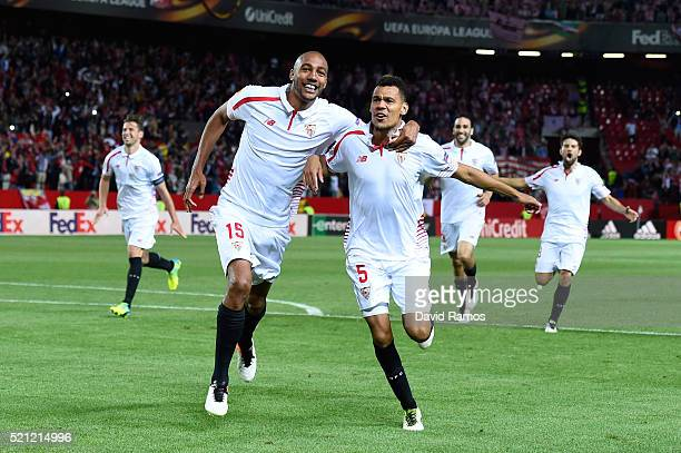 Steven N'Zonzi and Timothee Kolodziejczak of Sevilla celebrate victory after the penalty shoot out during the UEFA Europa League quarter final second...