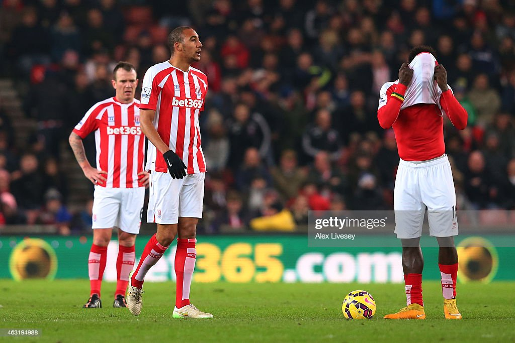 <a gi-track='captionPersonalityLinkClicked' href=/galleries/search?phrase=Steven+N%27Zonzi&family=editorial&specificpeople=6324480 ng-click='$event.stopPropagation()'>Steven N'Zonzi</a>, <a gi-track='captionPersonalityLinkClicked' href=/galleries/search?phrase=Glenn+Whelan&family=editorial&specificpeople=878267 ng-click='$event.stopPropagation()'>Glenn Whelan</a> and <a gi-track='captionPersonalityLinkClicked' href=/galleries/search?phrase=Mame+Biram+Diouf&family=editorial&specificpeople=8255767 ng-click='$event.stopPropagation()'>Mame Biram Diouf</a> of Stoke City react after conceding a goal during the Barclays Premier League match between Stoke City and Manchester City at Britannia Stadium on February 11, 2015 in Stoke on Trent, England.