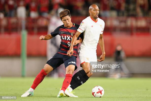 Steven N'Zonzi of Sevilla and Yuma Suzuki of Kashima Antlers compete for the ball during the preseason friendly match between Kashima Antlers and...