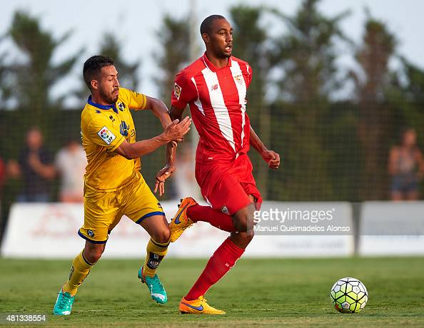 Steven N«Zonzi of Sevilla battle for the ball with Dani Toribio of Alcorcon during a Pre Season Friendly match between Sevilla and Alcorcon at...