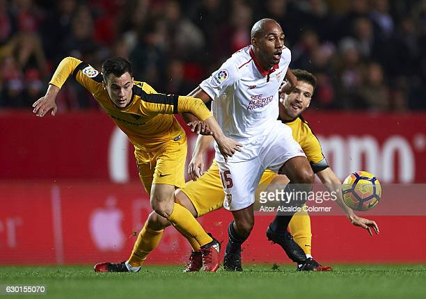 Steven N'Zonzi of Sevilla FC competes for the ball with Juan Pablo Anor 'Juanpi' of Malaga CF during the La Liga match between Sevilla FC and Malaga...
