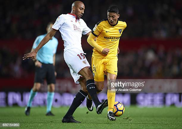 Steven N'Zonzi of Sevilla FC competes for the ball with Pablo Fornals of Malaga CF during the La Liga match between Sevilla FC and Malaga CF at...