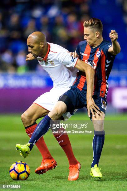Steven N'Zonzi of Sevilla FC duels for the ball with Marcos Llorente of Deportivo Alaves during the La Liga match between Deportivo Alaves and...