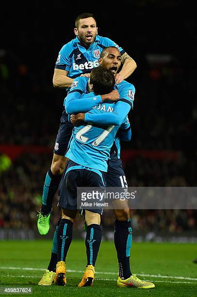 Steven Nzonzi of Stoke City celebrates scoring his team's first goal with his teammates during the Barclays Premier League match between Manchester...