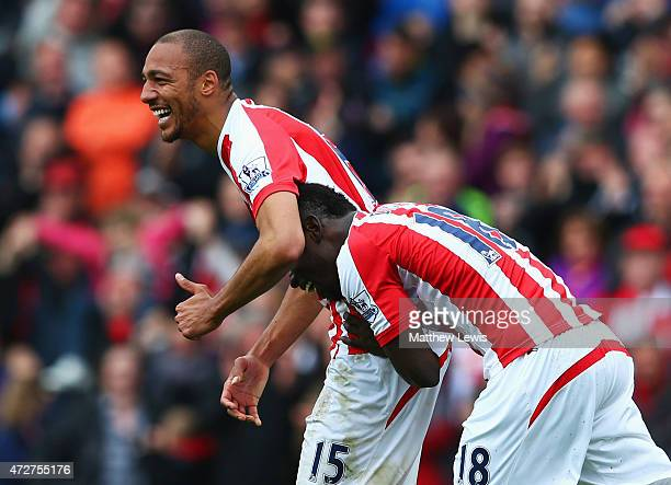 Steven N'Zonzi of Stoke City celebrates scoring his team's second goal with Mame Biram Diouf during the Barclays Premier League match between Stoke...