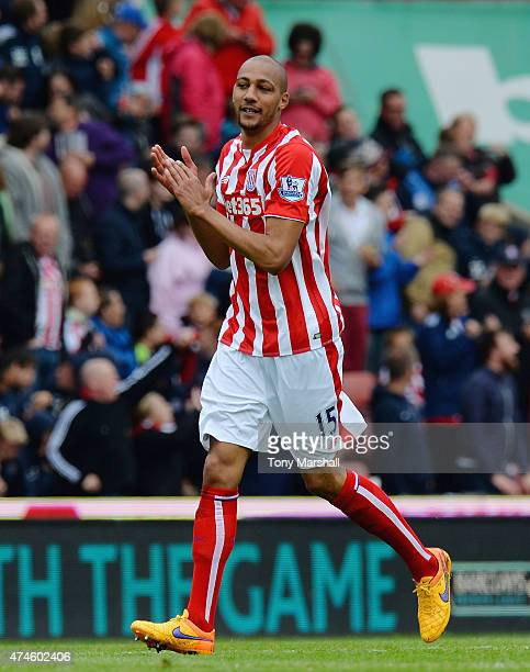 Steven Nzonzi of Stoke City celebrates scoring their fifth goal during the Barclays Premier League match between Stoke City and Liverpool at...