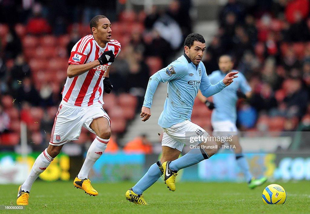 Steven Nzonzi of Stoke City chases <a gi-track='captionPersonalityLinkClicked' href=/galleries/search?phrase=Carlos+Tevez&family=editorial&specificpeople=220555 ng-click='$event.stopPropagation()'>Carlos Tevez</a> of Manchester City during the FA Cup with Budweiser Fourth Round match between Stoke City and Manchester City at Britannia Stadium on January 26, 2013 in Stoke on Trent, England.