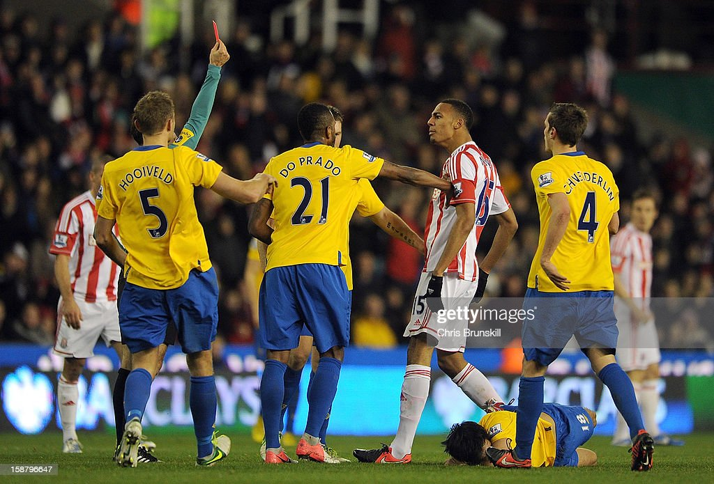 Steven Nzonzi of Stoke City is sent-off by referee Mark Clattenburg during the Barclays Premier League match between Stoke City and Southampton at Britannia Stadium on December 29, 2012 in Stoke on Trent, England.